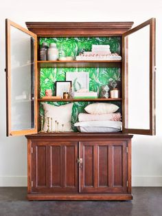 Refinish an old cabinet with new stain and a colorful shelf backer. Learn how + more fabulous furniture makeover tips here >> http://blog.diynetwork.com/maderemade/2015/09/09/diy-furniture-makeover-painting-distressing/?soc=pinterest