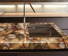 Handcrafted Slabs Of Amethyst Jasper Petrified Wood And Other Semi Precious Stones Bring A Unique Beauty To Counter Surfaces