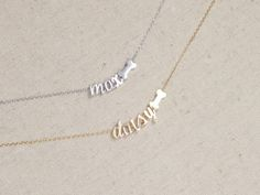 """***STOCK NOTIFICATION: Script letter i in rose gold is currently out of stock, any name orders needing one will experience a delay in shipping time*** Petite and adorable, this dog bone necklace with name is sure to show your love of all things puppy. This necklace is a great gift for someone that loves their pup of past or present. Details: -Comes on a rhodium, gold or rose gold plated chain that has a ring at 16"""" and 18. 18""""-20"""" option is available upon request. -Please leave your…"""