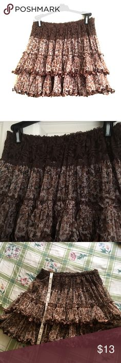 Sexy ruffle skirt Sexy brown flower lace skirt. Not tag but has never been worn. 95% polyester 5% spandex. Skirts Mini