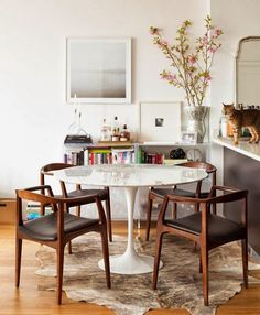 Kitchen eating area idea. Table and rug with ghost chairs instead