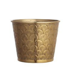 Pot in gold-colored metal with an embossed pattern. Height 4 3/4 in., diameter at top 6 in.