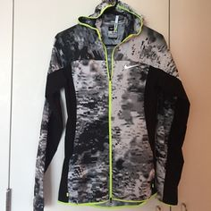 Nike running jacket xs Beautiful Nike running windbreaker in size extra small! Has a hoodie, reflective zippers and trims for night running. Inside pocket for keys. Extremely light. Worn once. Nike Jackets & Coats