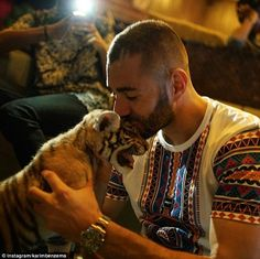 Striker Karim Benzema followed suit by having an affectionate encounter with a baby tiger during his holidays