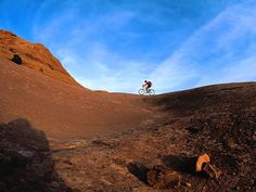 Slickrock, Moab, Utah. A must ride for mtn. bikers. The OG bike mecca.