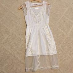 White dress with pretty detailing Unique dress with special detailing. Never worn except to try on twice Dresses Midi
