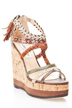 JImmy Choo. It'd be my style if I was more adventurous, not afraid I'd fall and bust my head open, and was willing to spend more than one thousand dollars on a pair of shoes. I bet I can find a pair of knockoffs, though... :)  $1095.00