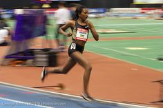 Tirunesh Dibaba  is an Ethiopian long distance track athlete and the outdoor 5000 metres world record holder photographed here at the 2012 New Balance Grand Prix. This a good example of a hand-panned shot taken at 1/50th sec.