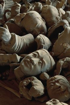 Terra Cotta Soldiers - China.  A jumbled heap of terra-cotta heads await reconstruction.  This archeological site is so extensive, it will take years to complete its analysis and restoration.