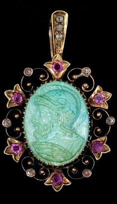 Unexpected combination of a turquoise cameo with rubies and diamonds set in a foliate and scroll motif, circa 1870