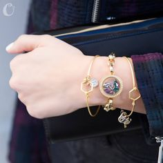 Pair a Link Locket with a Harmony Brushed Hex Bangle and your choice of Charms to add some extra sparkle to your outfit!