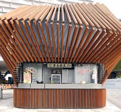 LAAB's kinetic 'harbour kiosk' in hong hong opens + closes using robotic timber fins - its cinematic transformation activates the surrounding public space. Kiosk Design, Signage Design, World Architecture Festival, Public Architecture, Architecture Design, Kinetic Architecture, Rose Tat, Environmental Graphic Design, Environmental Graphics