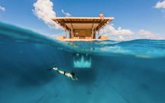 The Underwater Room is just what it sounds like: a hotel room that's submerged in the clear blue ocean. hotel in Pemba, Zanzibar - The Manta Resort - The Underwater Room Under The Water, Hotel Subaquático, Hotel Suites, Hotel Deals, Hotel Stay, Hotel Lobby, Dream Vacations, Vacation Spots, Vacation Ideas