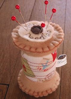 What a cute gift idea for someone who sewing.  Wonder if I could make this.