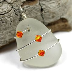 Sea Glass Pendant, Wire Wrapped #sea glass beads & #sea charms: http://www.ecrafty.com/c-780-sea-glass-beads.aspx?pagenum=1===newarrivals=60