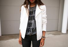 white collared cardi, graphic tee, black pants, gold necklace.