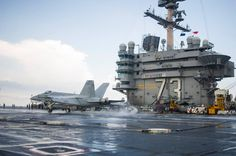"""SOUTH CHINA SEA (Nov. 2, 2013) An F/A-18E Super Hornet from the """"Dambusters"""" of Strike Fighter Squadron (VFA) 195 makes an arrested landing on the flight deck of the U.S. Navy's forward-deployed aircraft carrier USS George Washington (CVN 73). (U.S. Navy photo by Mass Communication Specialist 3rd Class Ricardo R. Guzman/RELEASED)"""