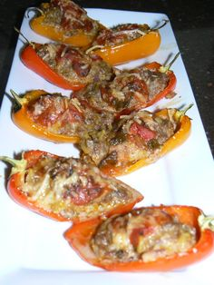 Unique Luxury Catering - Scottsdale, AZ, United States. Mini Stuffed Tri Color Sweet Peppers with Hot Italian Sausage, Rice, Garlic, Thyme, and Spices, House Marinara and Parmesan Romano