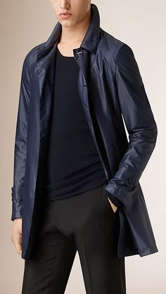 Burberry Navy Leather Detail Packaway Technical Car Coat -  A showerproof packaway car coat in a lightweight technical fabric.  The protective, single-breasted design features heritage-inspired tab cuffs and a a lambskin undercollar.  Discover the men's outerwear collection at Burberry.com