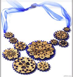 Modern Times magestic necklace in motion! Laser cut acrylic & wood with a gold touch & organza ribbon.