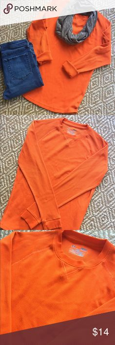 Under Armour Waffle Knit Top Perfect cool weather casual too. Orange waffle Knit, actually a men's small but looks amazing with jeans and a lightweight scarf!! Perfect condition! Under Armour Tops Tees - Long Sleeve