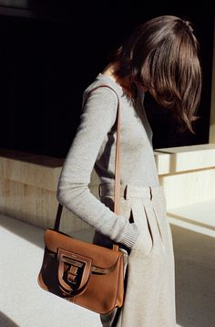Hermès - Vestiaire d'Hiver 2014. Halzan Bag in bullcalf, men's trousers in pebble grey felted cashmere tweed, round neck pullover in pebble grey Scottish cashmere #hermes #womenswear #fashion #hermesfemme