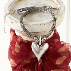 """Silver Rope Necklace with Heart Pendant. A Fashionista favorite!  Come check out our full fashion preview line-up at: https://www.facebook.com/media/set/?set=a.2086218078185584.1073741834.1906314106175983&type=3.  Make sure to """"LIKE"""" our page not to miss a sale!"""