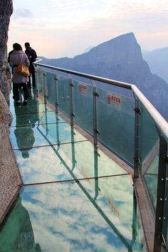 WOW. Glass Skywalk in China. Amazing transparent pathway is located 4,700 ft (1,430 m) above sea level on the side of Tianmen mountain in Zhangjiajie, China.