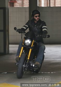 Keanu Reeves riding his motorcycle in Beverly Hills