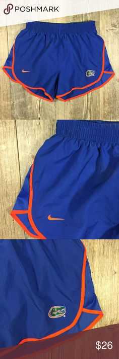 Nike UF Gators blue and orange running shorts Nike University of Florida Gators blue and orange running shorts. Elastic waistband. Drawstring waist. Liner attached. Nike Fit Dry. 3 inch inseam. 11 inches long. Tag reads XS. Nike Shorts