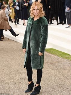 Stunner: Sienna wore her newly-copper locks in loose waves around her face with a centre parting, while the colour of her jacket perfectly set off the hue of her hair