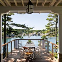 A porch leading to a deck overlooking a lake - perfection!