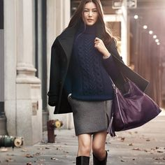 Supermodel Liu Wen- Love her navy blue cable knit sweater, grey skirt, black boots, black coat and the color of her coach purse.