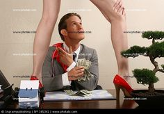 http://www.photaki.com/picture-businessman-sitting-in-an-office-looking-at-a-woman-standing-on-a-table_145341.htm