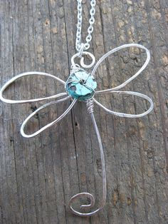 Crossley Design--Sterling silver wire wrapped and hammered dragonfly pendant with turquoise