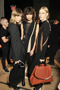 Models Edie Campbell, Mica Arganaraz and Julia Nobis strike a pose backstage at the BOSS Womenswear show in the new Fall/Winter 2016 collection
