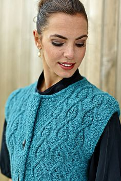 Ravelry: Arcade Vest pattern by Linda Marveng A straight vest inspired by Haider Ackermann's architectonic style and jewel colours. It features arcades knitted by cables, framed by double moss/seed stitch and ends with an I-cord trim around the neck and armholes. The double front gives the vest weight - close it as you prefer with a shawlpin or a belt. Close it at the top for a trendy look and an asymmetrical opening.