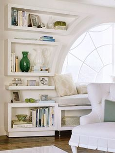 My dream master bedroom would HAVE to include an in-home library!  These bookcases and shelves flanking the window seat make it easy to grab a book and curl up and read.