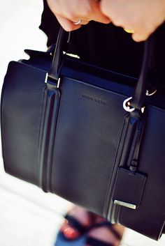 Kristina Bazan's black bag is from Hugo Boss