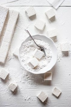 homemade fluffy marshmallows (corn syrup free) for your hot chocolate favors!   via: The Clever Carrot