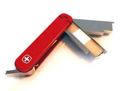 First Aid Swiss Army Knife - Has BandAids, a whistle, disinfectant spray, and a pillbox. I want this so badly!