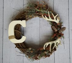 Beautiful Christmas wreath with antlers and pine cones!