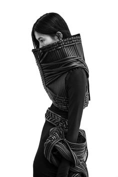 """The body itself is a most sacred garment…."""" by Sarah Ryan. The fusion of muscle to bone is illustrated using adverse textiles to create a new informed silhouette in achromatic black."""