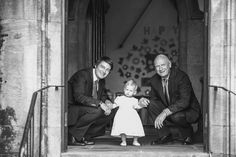 The Shepherds church christening photography, candid shot of the fathers and isabella