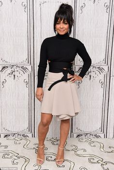 So chic:Christina Milian looked classic chic in a high neck black top with sophisticated cutouts around her waist
