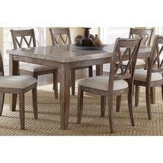 the rustic style of the fulham dining table is evident in its washed grey finish and