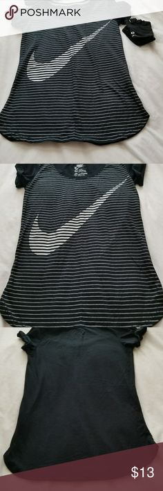 Black and silver logo Nike shirt This short sleeve top has like a roll on the cap sleeve and a shiny logo in silver . I wore it one time andvwashef it , layer it flat to dry . And the next it was snug in me . I bought it to small to start . My loose .Very cute top. Nike Tops Tees - Short Sleeve