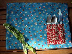 One of these travel placemats made in oilcloth would be great for eating out with the toddler.