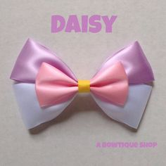 Up for your consideration is a custom made daisy hair bow.    The bow measures 5 inches wide and 3 inches tall. I will attach whichever clip you