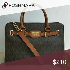 "Michael Kors large Hamilton EW tote brown bag MK BRAND NEW IN FACTORY PLASTIC! *Authentic *NWT *Style # 35F0GHMT3B *LG Monogram logo EW PVC Hamilton tote *Brown color *Leather trim *Gold-tone hardware *Magnetic snap closure *MK plaque on front *Buckle detailing *Measurements: 10.5"" H x 14.75"" L x 6"" D *4.5"" leather handles *Attached 16"" shoulder strap with chain design *Inside slip (4) and zip (1) pockets and a divider zippered compartment *UPC 885949685965  Please no trades,price is firm…"